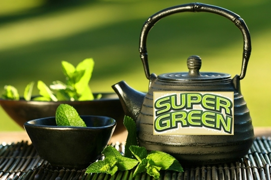 Black iron asian teapot with sprigs of mint for green tea the cancer fighter